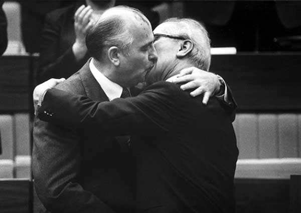 Totalitarian communist love: Erich Honecker getting to know the new boss, Gorbachev.