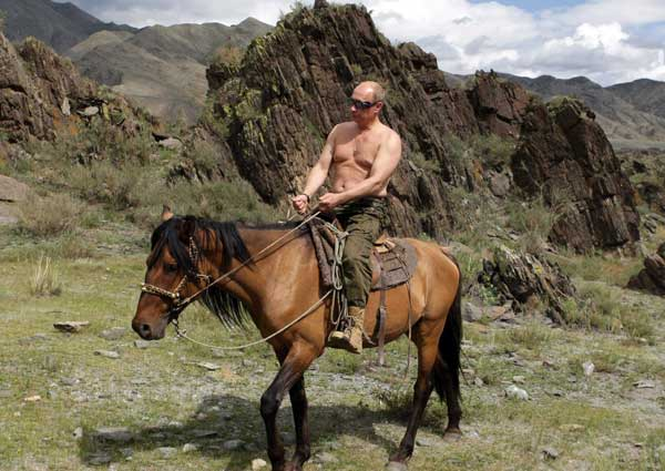 Shirtless Putin. Horse. Weird 50's era nuclear test goggles.